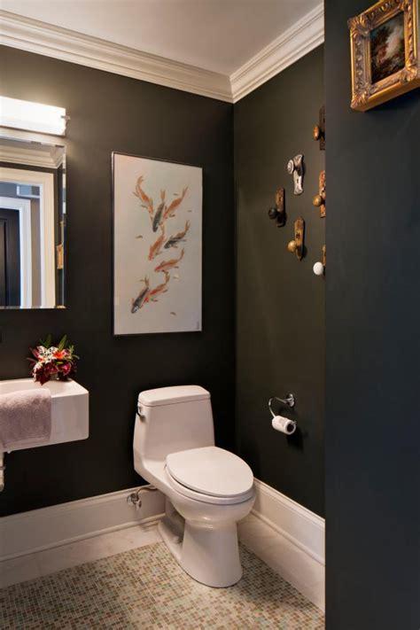 powder room features fish art wall  antique doorknobs