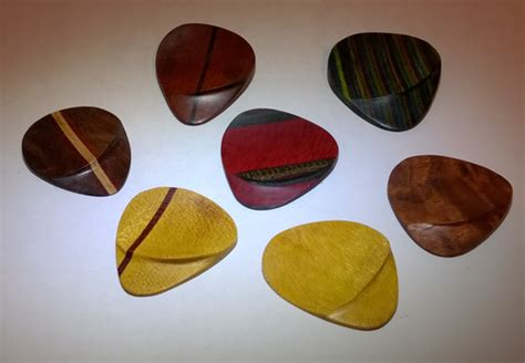 Buy A Custom Wooden Guitar Picks With Handshaped Thumb
