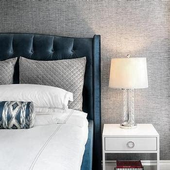 dark blue velvet wingback art deco bed  white  gray bedding transitional bedroom