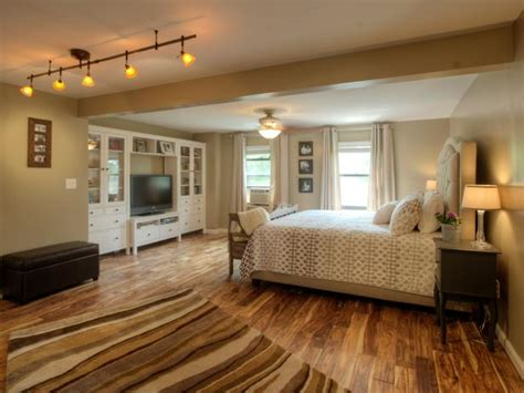 neutral transitional bedroom  hand scraped wood floors