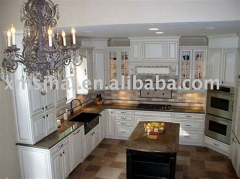 tropical brown granite white cabinets tile floor