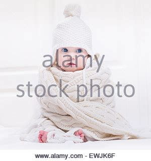 Wearing A Hat After Shower by Toddler With Big In A Blue Hooded Towel
