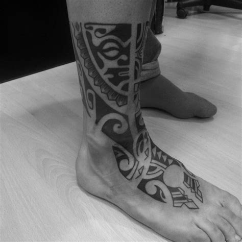 tribal ankle  foot tattoo