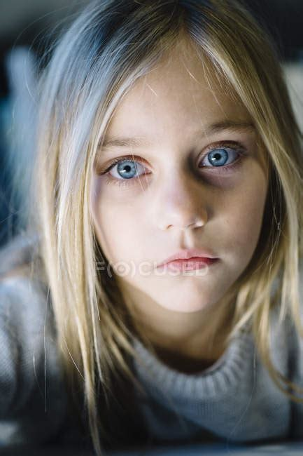 beautiful blonde preteen girl  big blue eyes