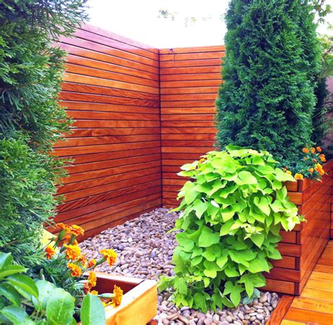 nyc roof deck roof garden terrace fence planter boxes container plants zen contemporary