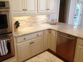 travertine backsplash with bone white cabinets crema romana granite ge cafe cdwt980vss