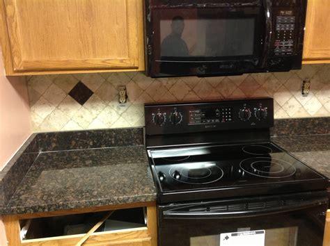 granite kitchen backsplash donna s brown granite kitchen countertop w travertine backsplash granix