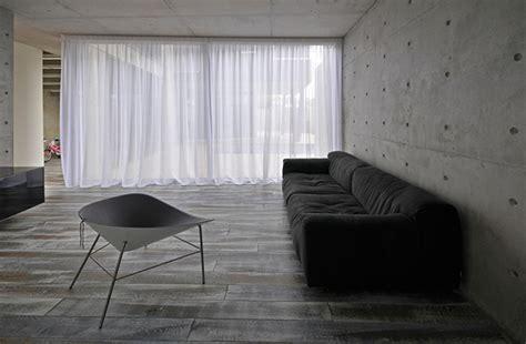 industrial minimalist interior unpolished modern home in cyprus blending industrial elements with minimalist design