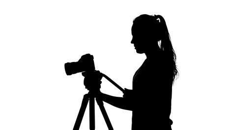 photographer tripod silhouette photographer works with a tripod white silhouette stock