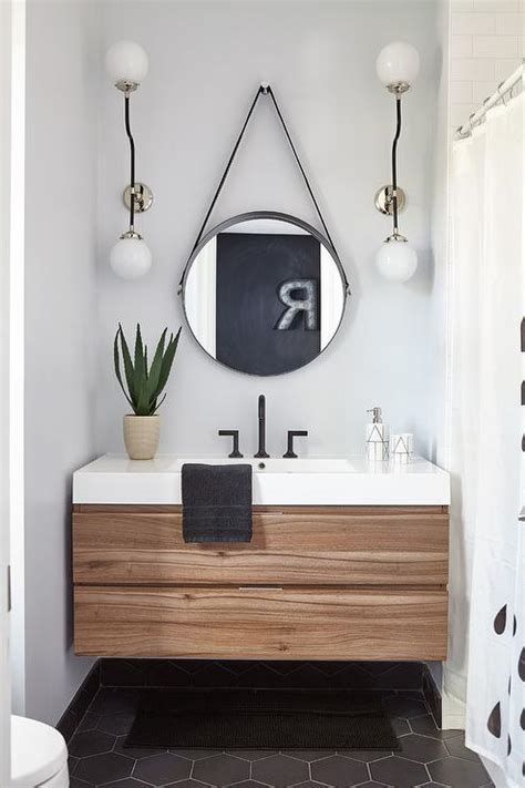 black hex tiles  brown wooden floating sink vanity