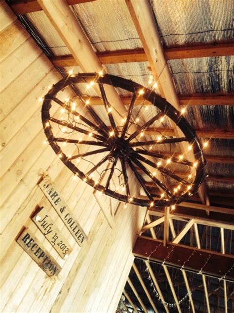 25 best ideas about wheel chandelier on wagon
