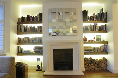 living room with fireplace and bookshelves exposed brick wall surround fireplace wit white mantel
