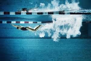 Female swimmer underwater in pool. Swimmer's Ear