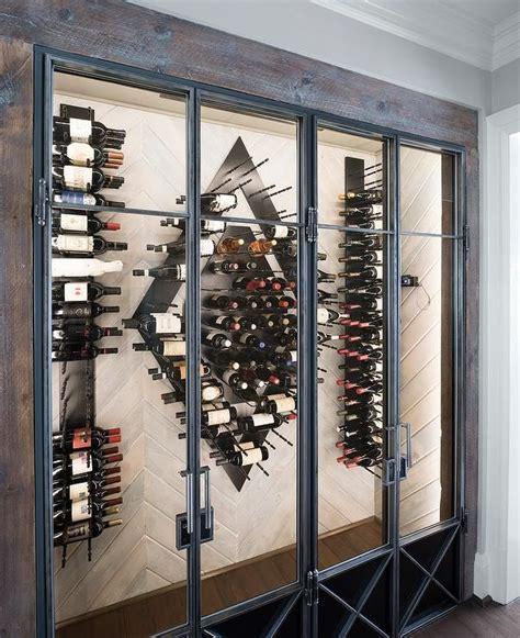 contemporary wine room features  wood herringbone wall