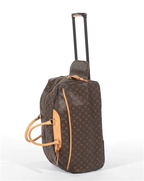 louis vuitton eole  monogram canvas rolling duffle bag