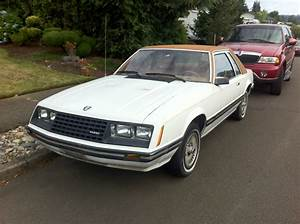 OLD PARKED CARS.: 1980 Ford Mustang Ghia.