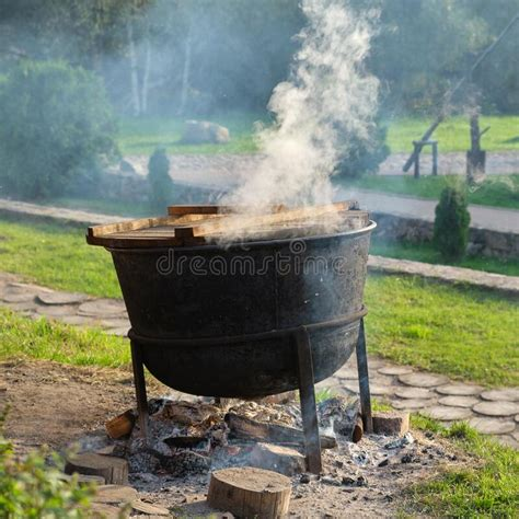 tourist camp  kettle   tourist cooking pot camping tents  folding chairs stock photo