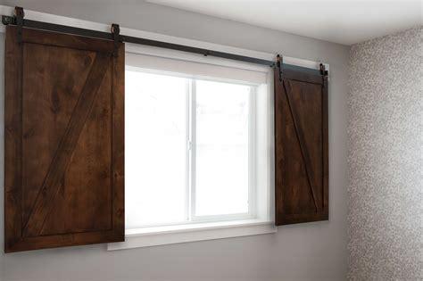 Barn Door Window by Biparting Sliding Barn Door Shutters Rustica Hardware