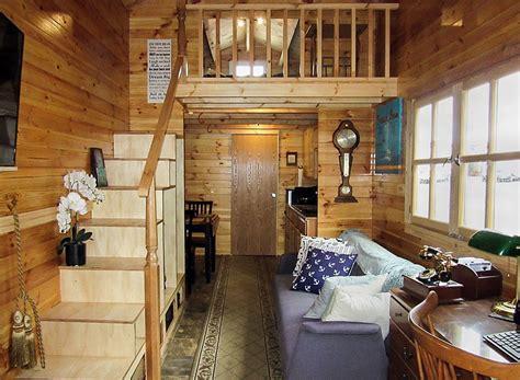 tiny cabin  wheels  realwood tiny homes