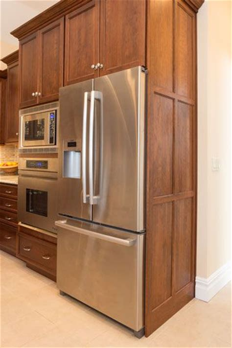 kitchen cabinets refrigerator panels the refrigerator is housed in a cabinet with decorative