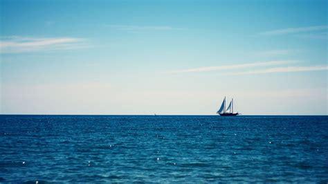 minimalism clouds sailing ship water sea horizon