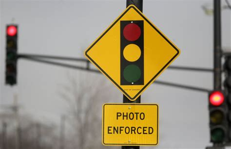 challenge red light camera ticket looming lawsuit has rahm trying to give 1 5 million