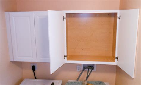 how to hang cabinets tips for hanging wall cabinets projects by zac