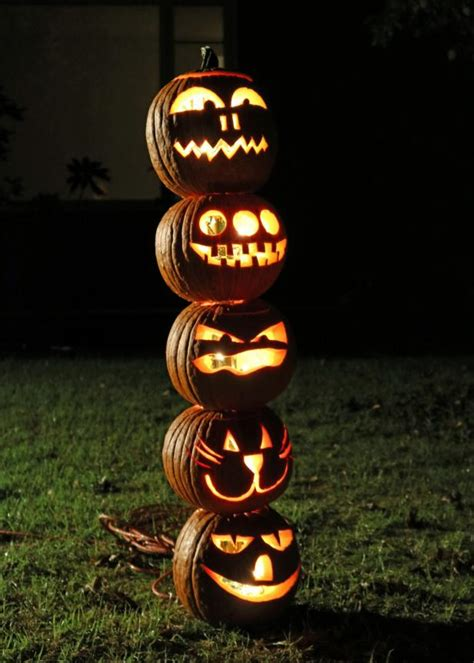 stack and light the pumpkins for a creative outdoor display