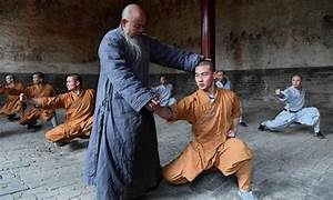 Monks practice martial arts at Shaolin Temple in central ...