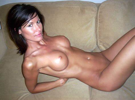 Pretty Ebony Blue Haired Strips And Plays On The Couch