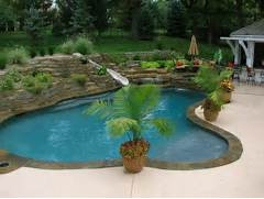 Living Tropical Pool Kansas City By Banks Pool Spa Design Pool Waterfalls And Ample Greenery Design Estate Pools Landscapes Tropical Pool Area And Small Garden Around It Brings Ambiance Of An Tropical Pool Designs Home Design Lover Best Backyard Pool