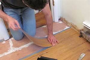 How to install vinyl plank flooring bob vila for How to install linoleum floor in bathroom