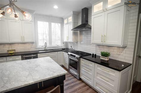 white brown shaker cabinets black white granite kitchen remodel sembro designs