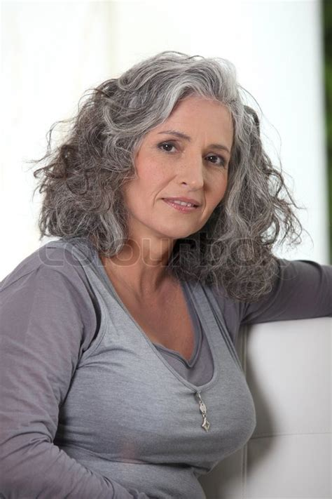 grey haired retired woman   lot  stock image