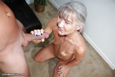 Big Grey Haired Woman Plays With A Speculum