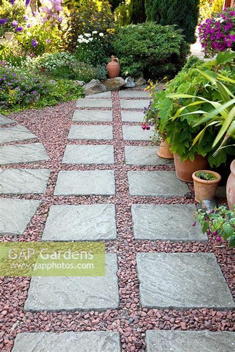 paving and gravel gap gardens stone paving slab and gravel patio image no 0211564 photo by elke borkowski