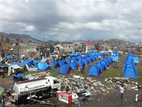 yolanda survivors arrive  ncr tent city set