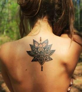 elegant lotus flower tattoo