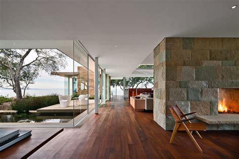open layout  sided large block fireplace glass walls
