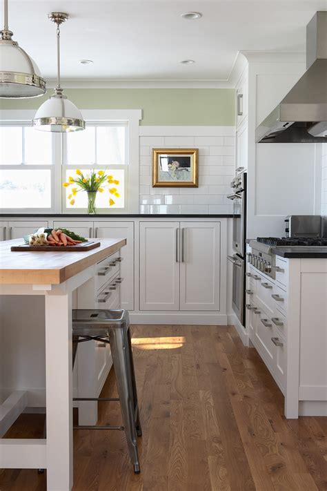 Eat In Island Kitchen - natural oak flooring kitchen contemporary with clerestory windows counter stools