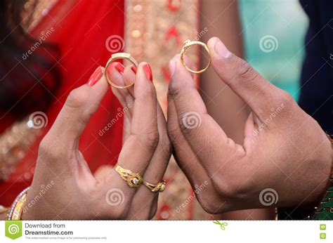 bride and groom hand with wedding rings