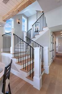 Iron Stair Rails With White Oak Wood Floors And Overhead