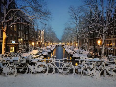Snow Has Fallen Down In The Centre Of Amsterdam © All