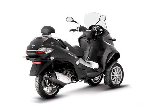 piaggio mp3 300 2011 piaggio mp3 300 hybrid pics specs and information onlymotorbikes