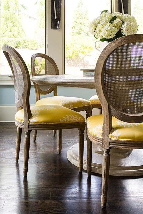 marble top dining table   cane  chairs
