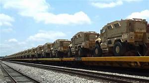 MRAP Military Transport Vehicles ready to be hauled by ...