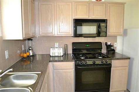 pickled oak cabinets granite kitchen with oak cabinets with black appliances 715