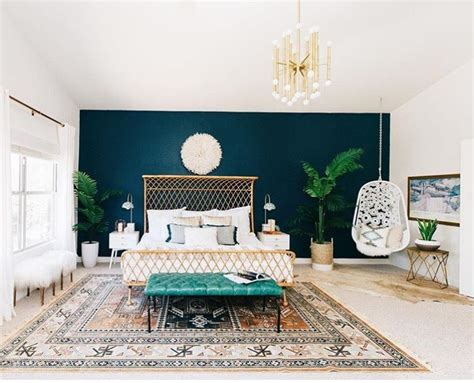 dark blue accent wall pops of gold and teal grounded