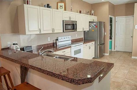 brown kitchen cabinets with white countertops tan brown granite countertops pictures cost pros and cons 156 | 10 tan brown granite countertops with white cabinets