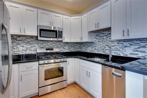 granite countertops and cabinets pictures of kitchens with white cabinets and dark